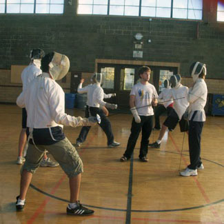 Fencing practice in full gear