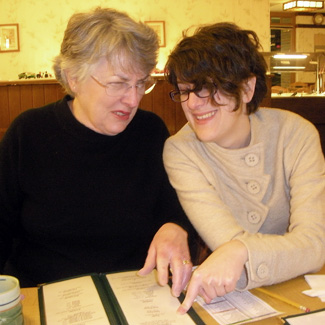 2 women look at a menu