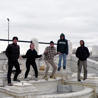 Five people on a marble structure