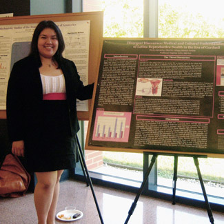 Cindy shows a research poster