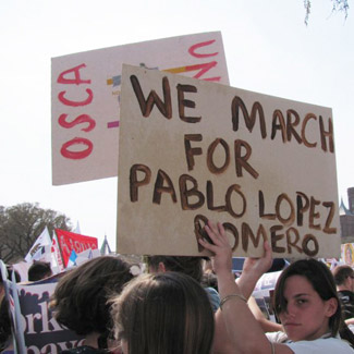 Protesters holding a sign reading We March for Pablo Lopez Romero