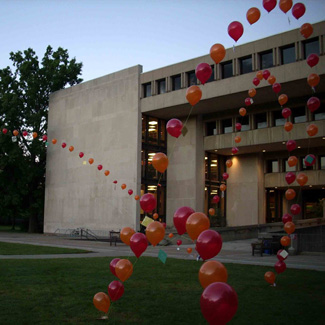 Arches of balloons in front of the Mudd building