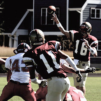 A quarterback releases the ball toward a receiver