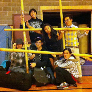 A group of students posing in a gym (wearing street clothes)