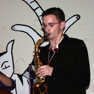 Jonah plays alto sax at the Cat in the Cream coffeehouse