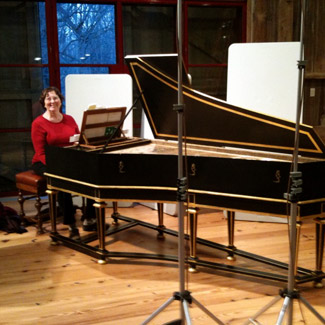 Karen seated at a harpsichord