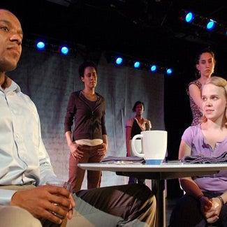 Actors rehearse a scene.