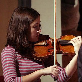 Mariko practices violin.
