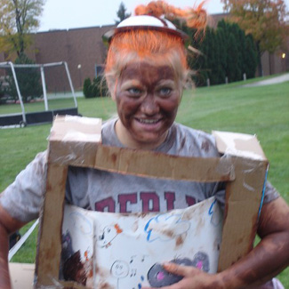Meghan wears a honemade, cardboard TV costume at the soccer field.