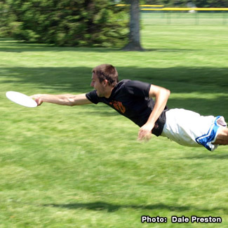 Mike appears to fly while diving for a Frisbee.