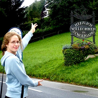 Nora points out a sign in German: Herzlich Willkommen in St. Wolfgang.