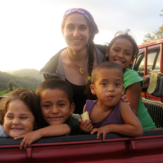Rachel in the company of 4 young Nicaraguan children.