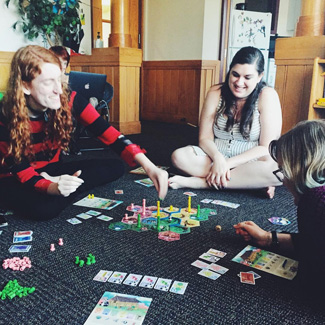 Sammy and friends play a boardgame.