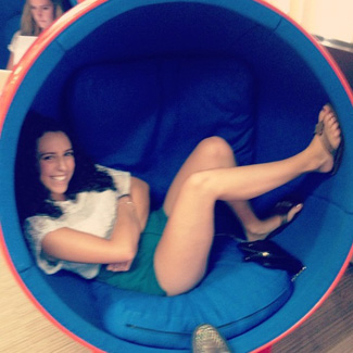 Sarah relaxes in a 'womb chair.'