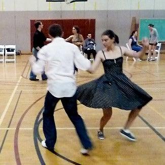 Ballrooom dance rehearsal in a gymnasium.