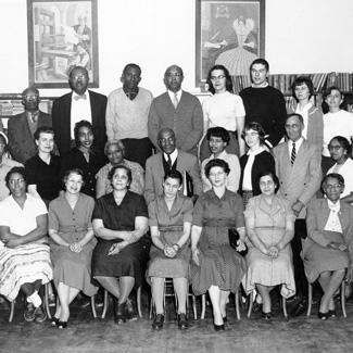 A group of two dozen people, many of them black and some white. Circa 1960.