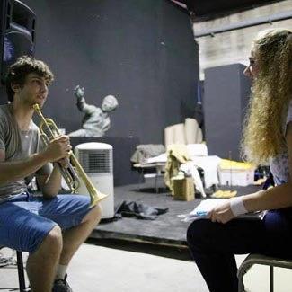 Zach holding a trumpet.