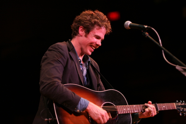 Josh Ritter playing acoustic guitar