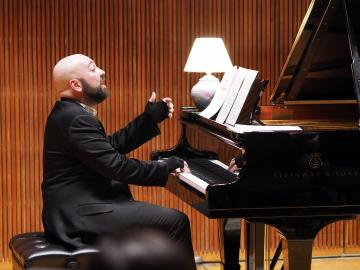 Pianist performing on stage