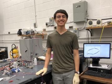 Andrew Santiago in a lab