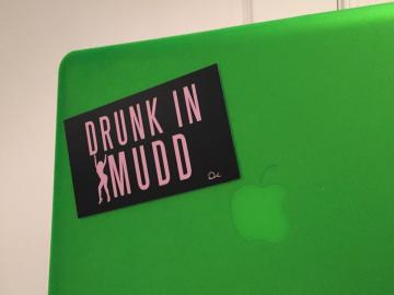 Sticker on a computer says 'Drunk in Mudd'