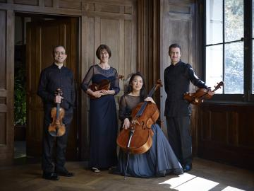 String quartet pose with instruments