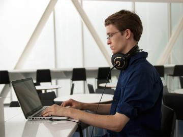 Eli Stine '14 posed with computer