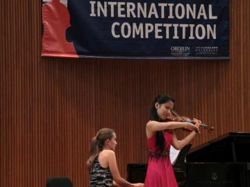 Angela Wee of New York performs in the Semifinal Round of the 2013 Cooper International Competition