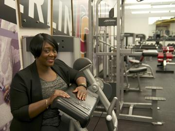 Donna Russell next to fitness equipment
