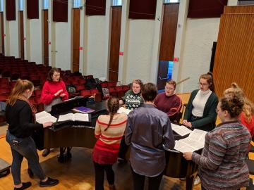 Oberlin College Student Olivia Fink leads a choir sectional in Warner Concert Hall