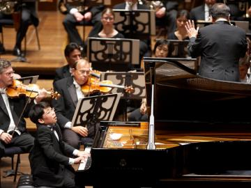 George Li Performing on piano with the Cleveland Orchestra.