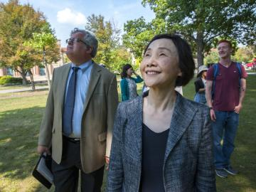 Tomoko Watanabe walks with Gavin Tritt and others in Tappan Square