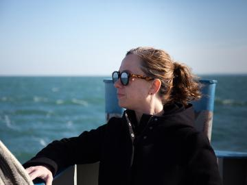 Julia Christensen standing on the ferry to South Bass Island