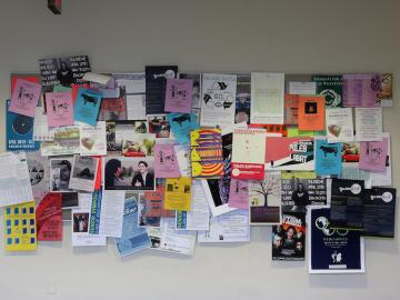 Picture of a board covered in posters