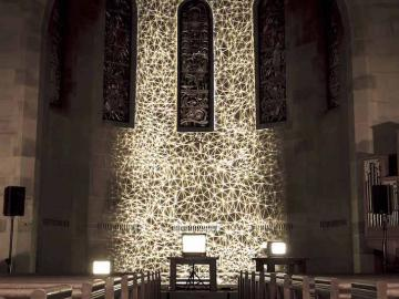 Photo of a light projection on a chapel wall