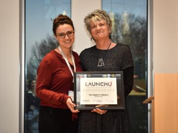 Director of Entrepreneurship Elyzabeth Holford and Alesandra Zsiba '10 with LaunchU award