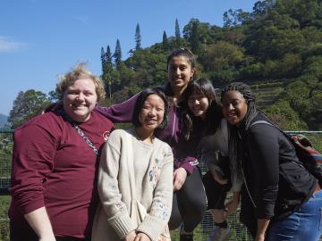 Five students pose at the Kadoori Farm and Botanic Garden in Hong Kong