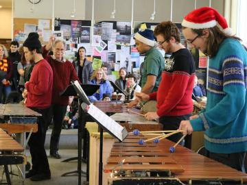 students perform in the Conservatory Lounge for Marimba Christmas