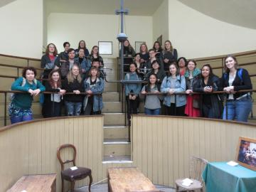 group poses during a visit to the Old Operating Theater and Herb Garret in London