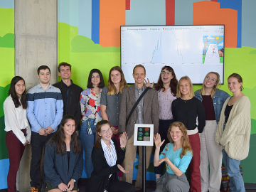 The Oberlin College Environmental Dashboard team in front of the now interactive Cleveland Environmental Dashboard Exhibit.