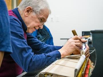 person providing maintenance to a piano