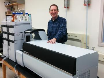 Prof. Thompson and lab equipment