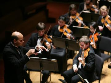 Conductor leading orchestra.
