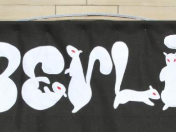 "Banner of ""Oberlin"" spelled in the shapes of squirrels"