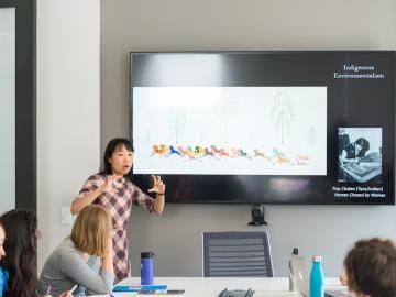 Professor teaching in StudIOC classroom