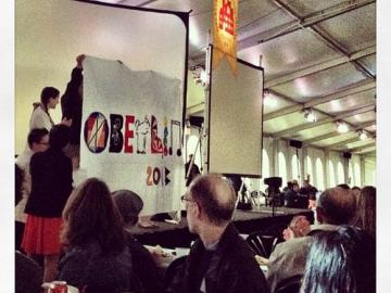 People hold up a homemade banner that reads 'Oberlin 2013'
