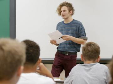 Man teaching in classroom.