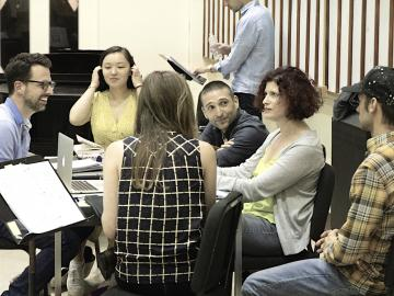 Composer Rachel J. Peters with 7 members of the workshop cast and crew of her opera The Wild Beast of the Bungalow.