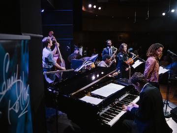 student musicians on stage in jazz venue.