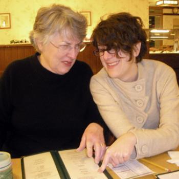 2 women look at a menu
